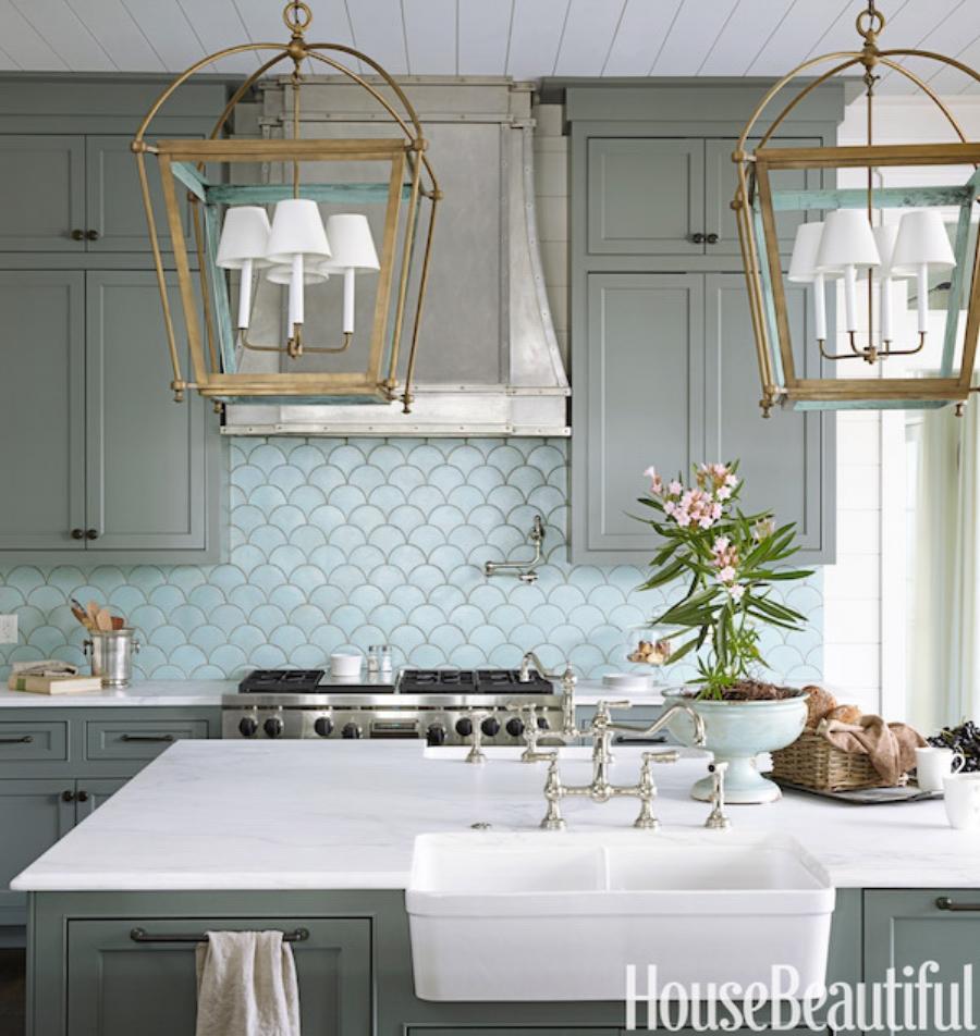 Bright blue fish scale backsplash makes this a unique but traditional kitchen