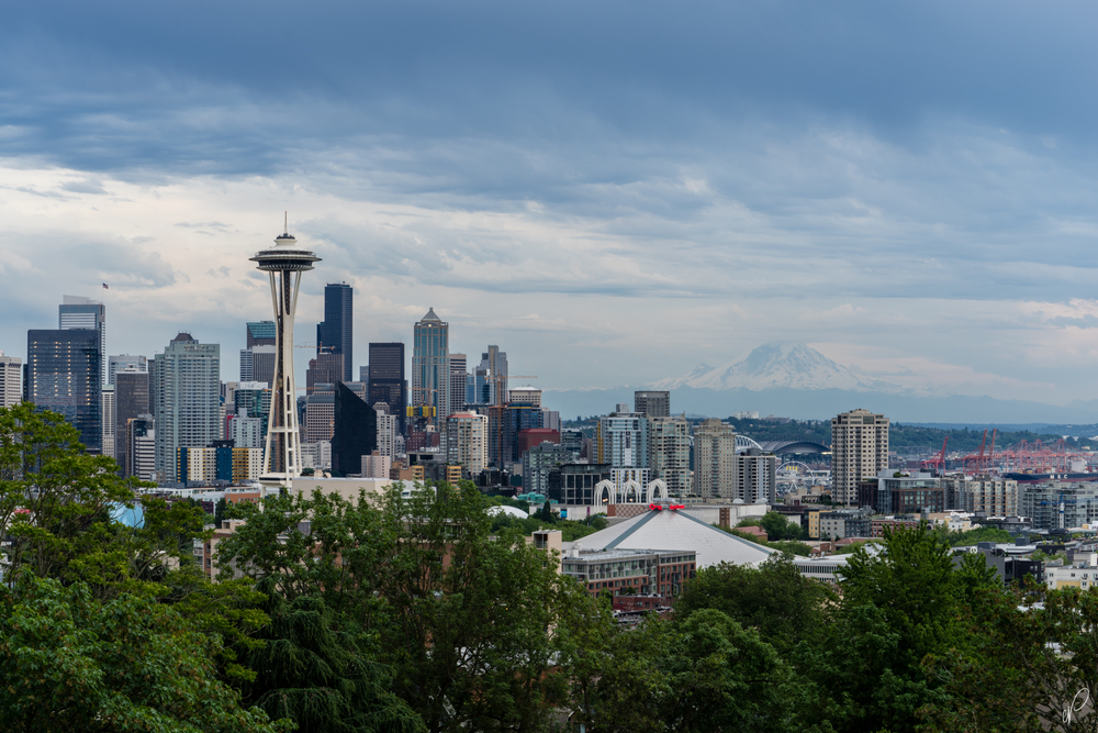 Rainier looms over Seattle in the background as a storm moves in.