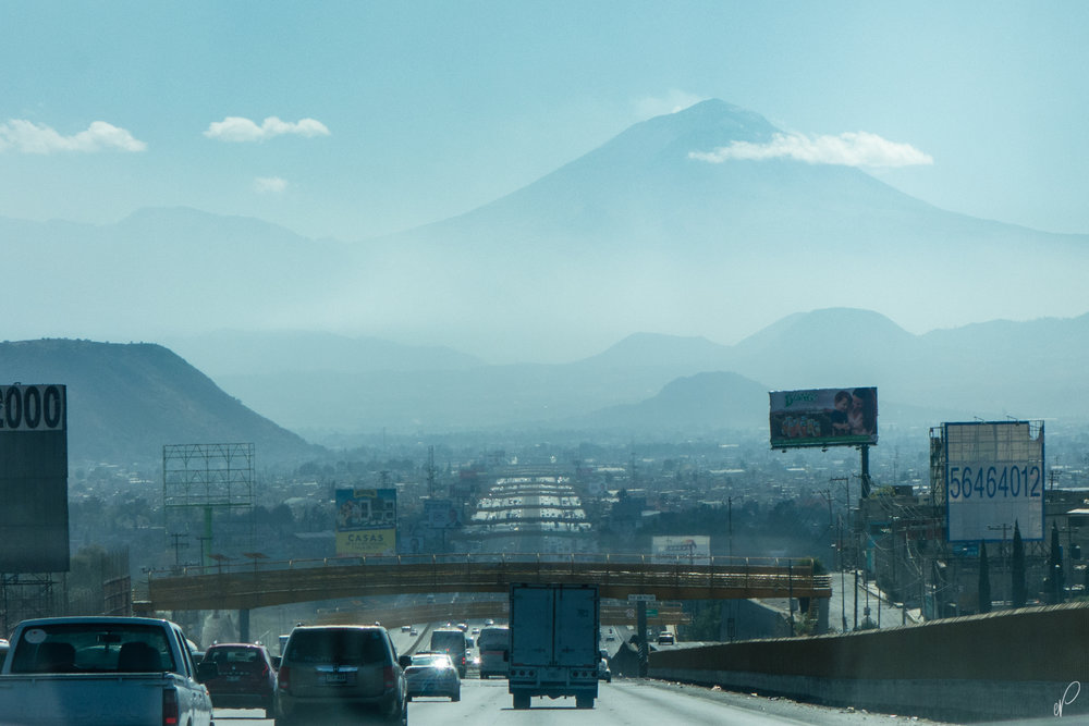Popocatepetl as seen from the suburbs of Mexico City. Izta (not in photo) is to the left, and the Altzomoni mountain pass is visible just to the left of the Popo.