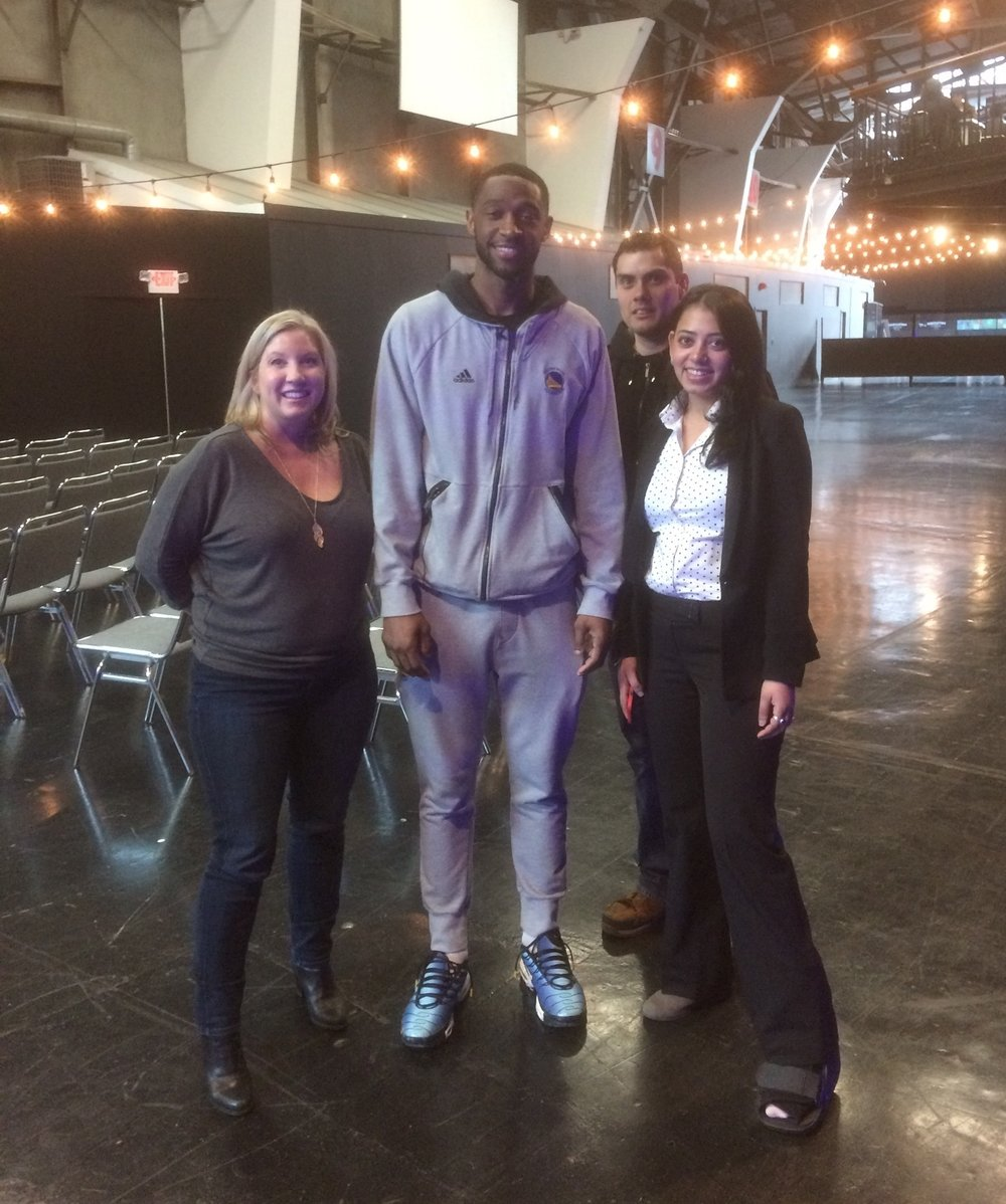iHangar staff Bethany Shine, Tooba Durraze and Mike Ramirez pictured with Warriors' Shooting Guard Ian Clark