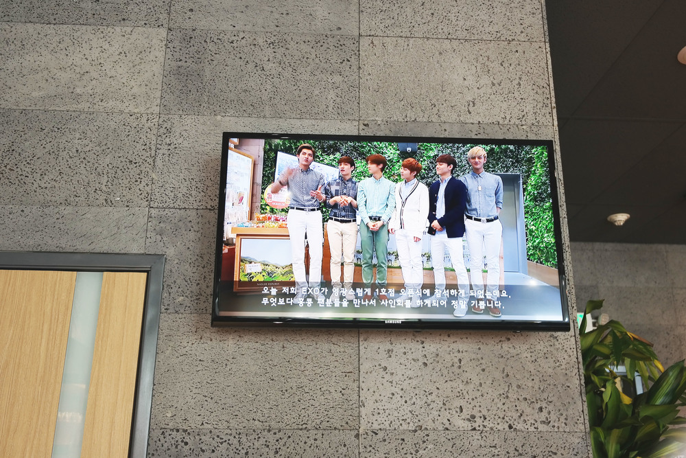 The store plays the latest Kpop and has a TV that plays clips of EXO and everything related to Nature Republic.