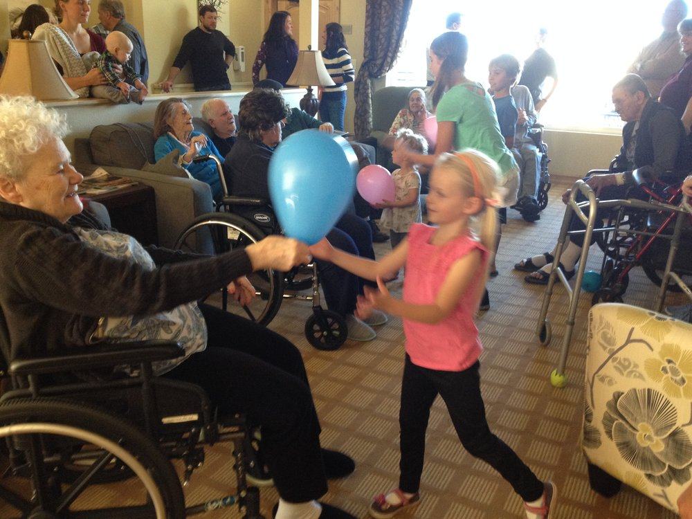 Playing Games - We played balloon games, sang songs and encouraged the residents at Pine Trails
