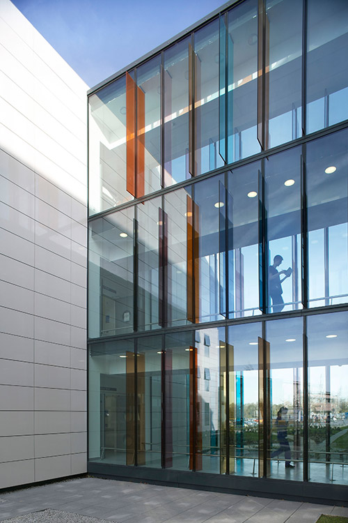Chesterfield Royal Hospital Ward & CareyGlass. Beautiful walkway featuring colored glass louvres.