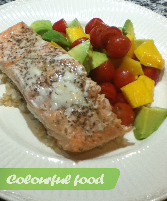 Salmon with mango, tomato and avocado salad