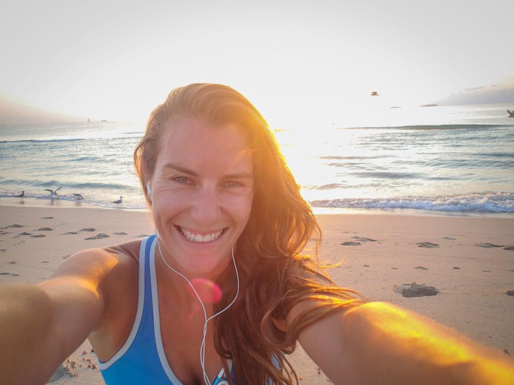 Smiling running sunrise beach