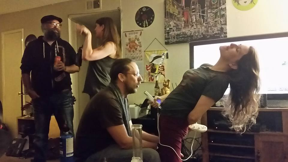 "The Viking's latest photographic performance art. L to R: Randle Aubrey, Mistress Mary, Fuckin' Harrison, Jessa On The Mic. No video game controllers were harmed in the production of this picture; Harrison's pretty good about the whole ""no teeth"" thing."
