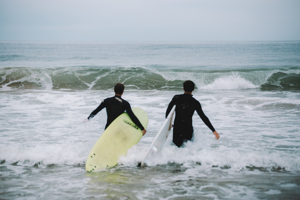 just two barney's heading out to the surf