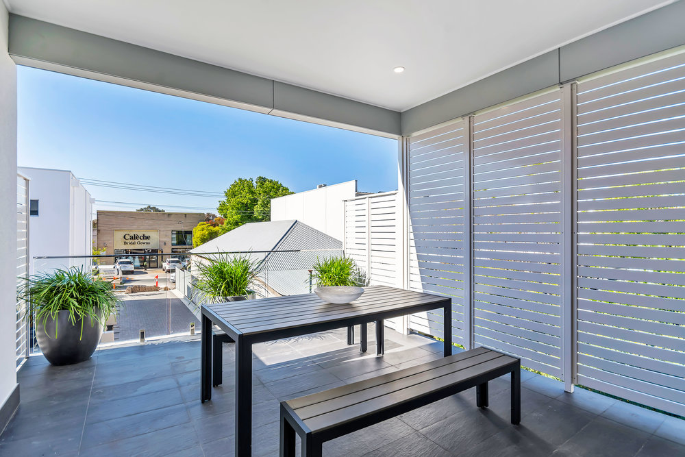 An amazing entertaining space - all weather Alfresco with beautiful powder coated privacy screens