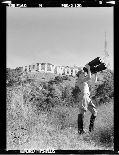 "Probably my most iconic photograph of Amber Heard. I call it ""Hollywood Dreaming"". We climbed up to the sign one early morning to grab the early light. I had this image, with these huge binoculars, in my head for a year before finally creating it. It's as if she is looking for stardom in her early days in Tinseltown. Please don't judge people you don't know. Amber is such a sweetheart and would not have accused Johnny Depp of abuse if it wasn't true. It's just not her nature. And she is not a gold digger. Sending strength your way, Amber. Shot on a Contax 645 Medium Format camera. 2006 ©Victor Spinelli. A 40x60 (100x150cm) Mixed media painted canvas of this image hangs at Ibiza Rocks House at Pikes in Spain. Limited signed prints available only upon request. Please inquire at: Hello@SPiNgalleries.com"
