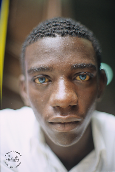 A portrait  I took in Havana, Cuba of a cigarette seller. Check out those blue eyes! Taken with E-6 Slide film & 50mm 1.8 Nikon lens