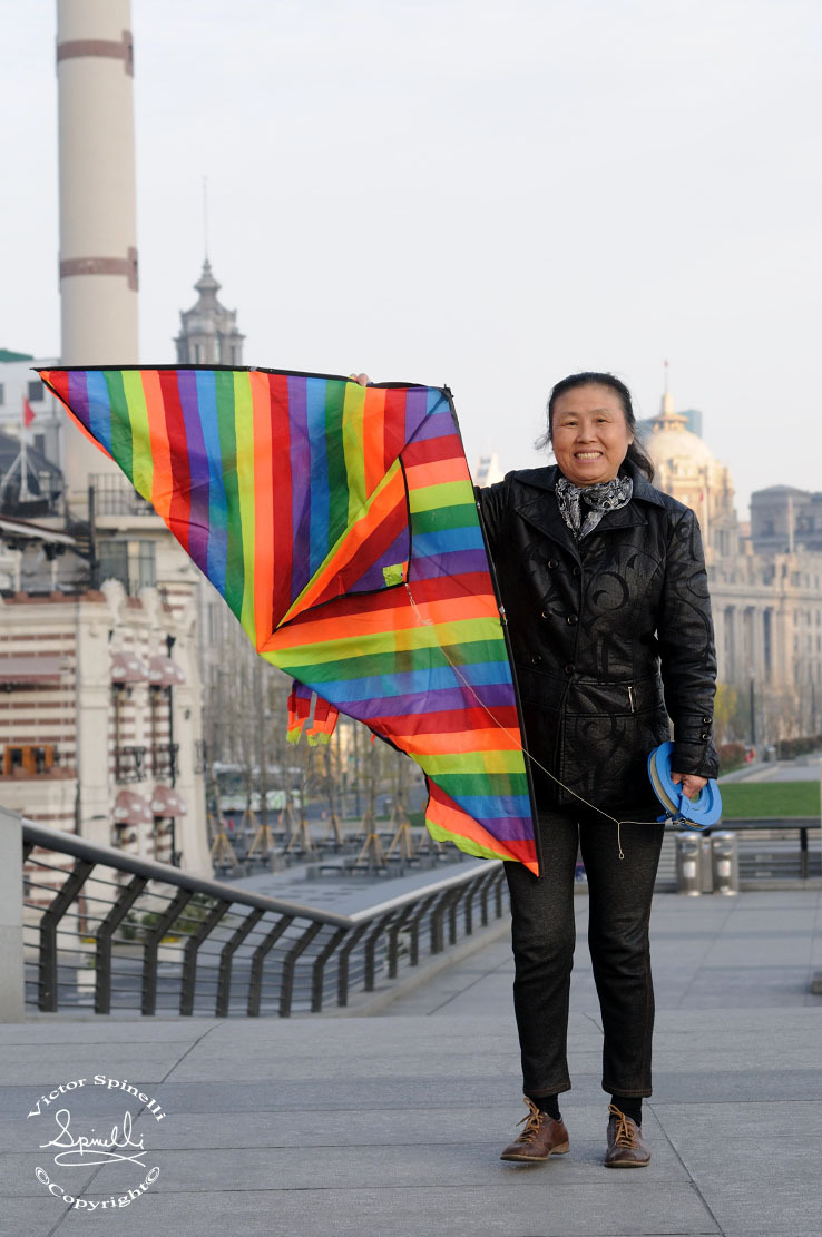 Some People of Shanghai. Kite flier on The Bund.