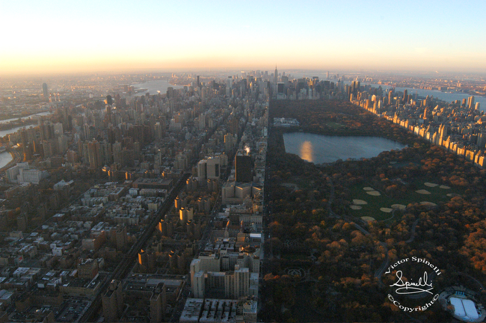 Photo of the Day:  New York City looking south straight down 5th Avenue with Central Park on the right. I took this from a helicopter at sunrise. ©Victor Spinelli Archive