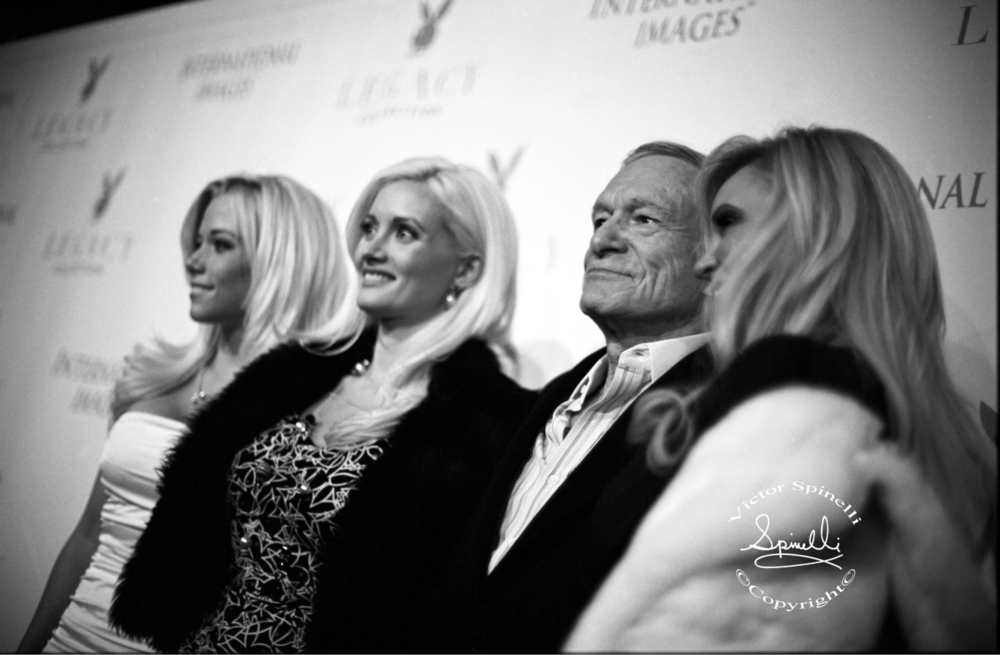 Photo of the Day:  Hugh Hefner and Holly Madison (on his right) with some Playboy bunnies, on the red carpet in Hollywood. 2007. ©Victor Spinelli Archive. Nikon f3 Kodak Black & White film.