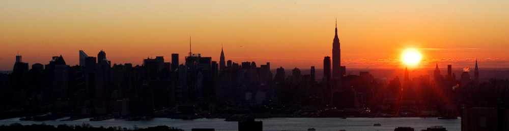 Photo of the Day: New York City skyline at sunrise. Taken on the WB Traffic helicopter in December 2005. ©Victor Spinelli