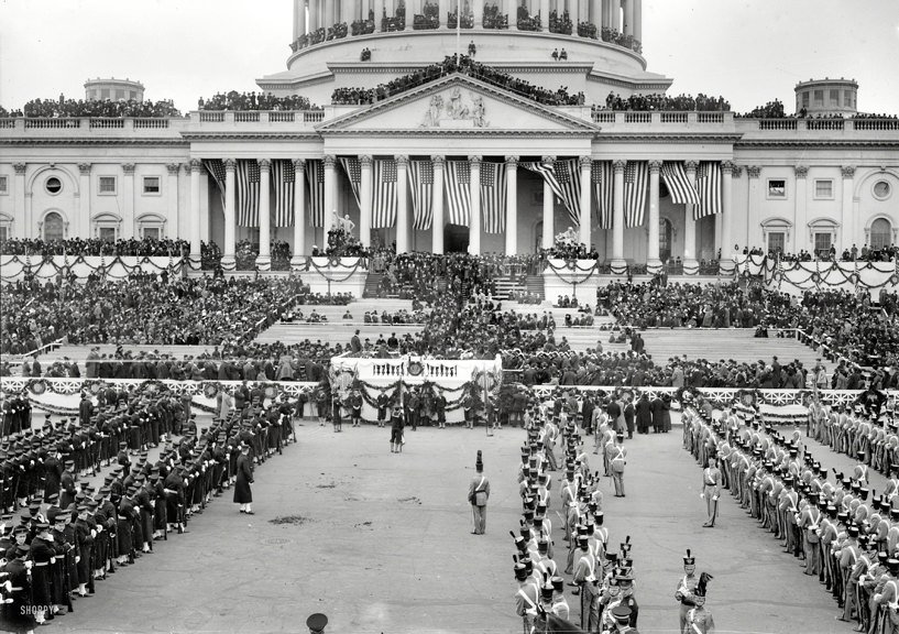 Woodrow Wilson's Presidential Inauguration in 1913. I love the guys hanging off the edge at the top of the Capitol.