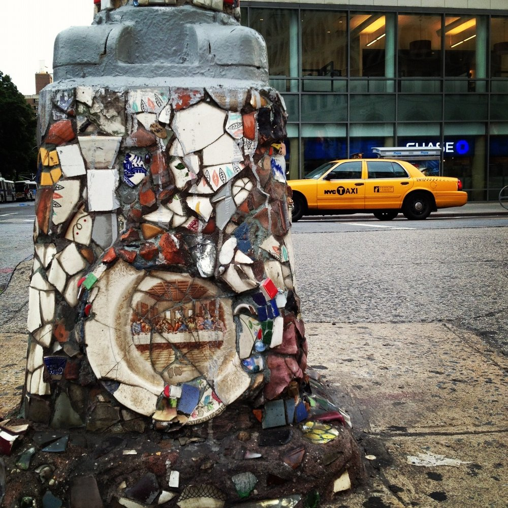 The full shot of the mosaic lamp post with 'The Last Supper' featured.