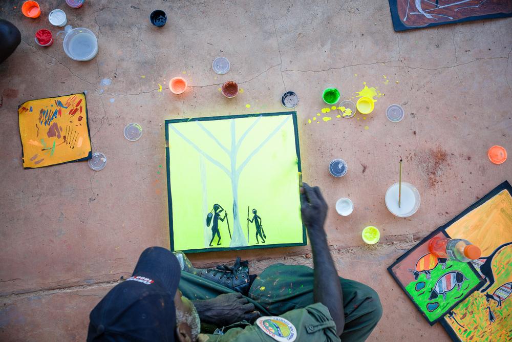 Ranger and artist Greg Wilson making a start on a fluoro masterpiece. Photo Hugo Sharp.