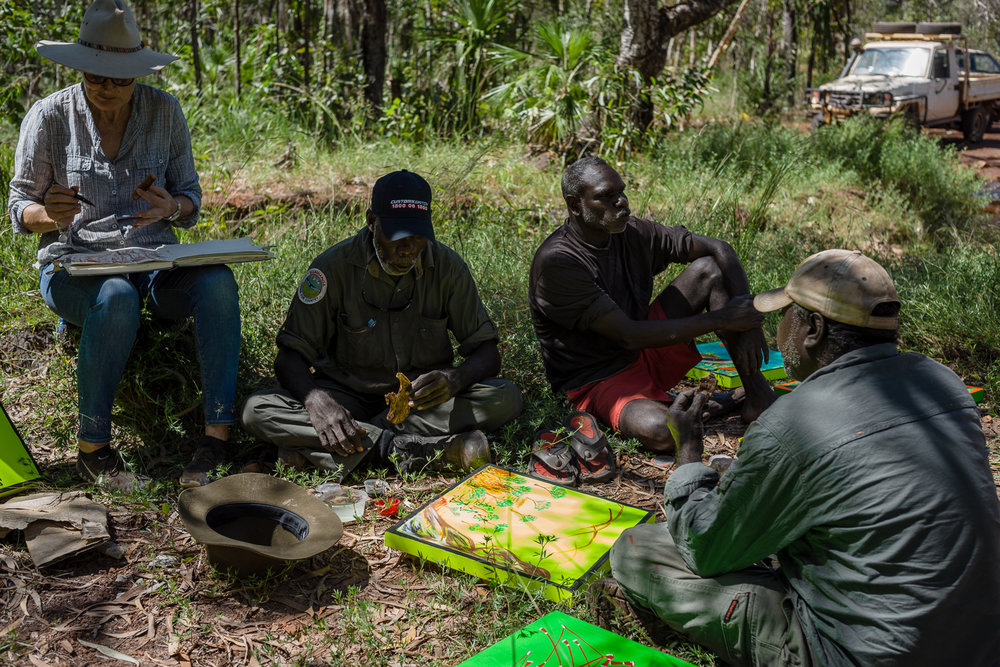 Mandy Martin and Djelk Rangers painitng at first creek. Photo Hugo Sharp.jpg