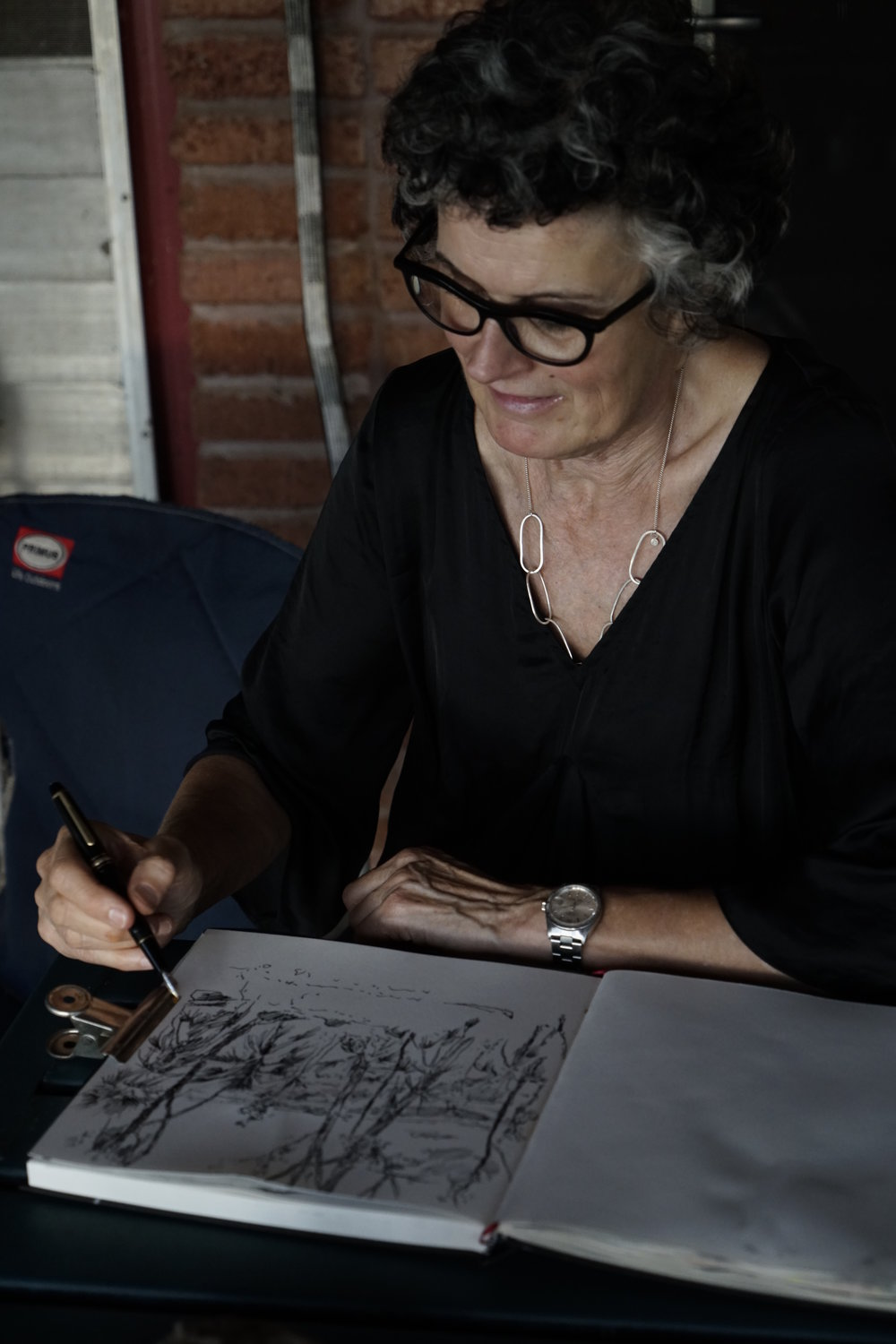 Mandy Martin drawing at Djinkarr. Photo Guy Fitzhatdinge.JPG