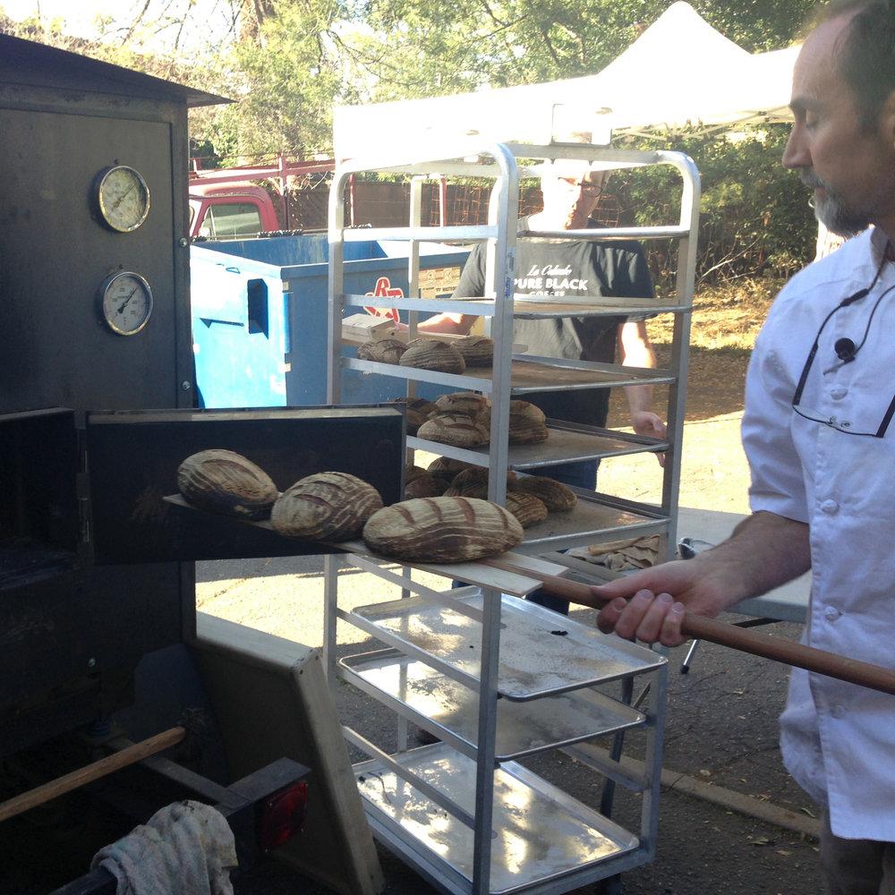 Dave Miller using oven at Zane Grey estate bak copy.JPG