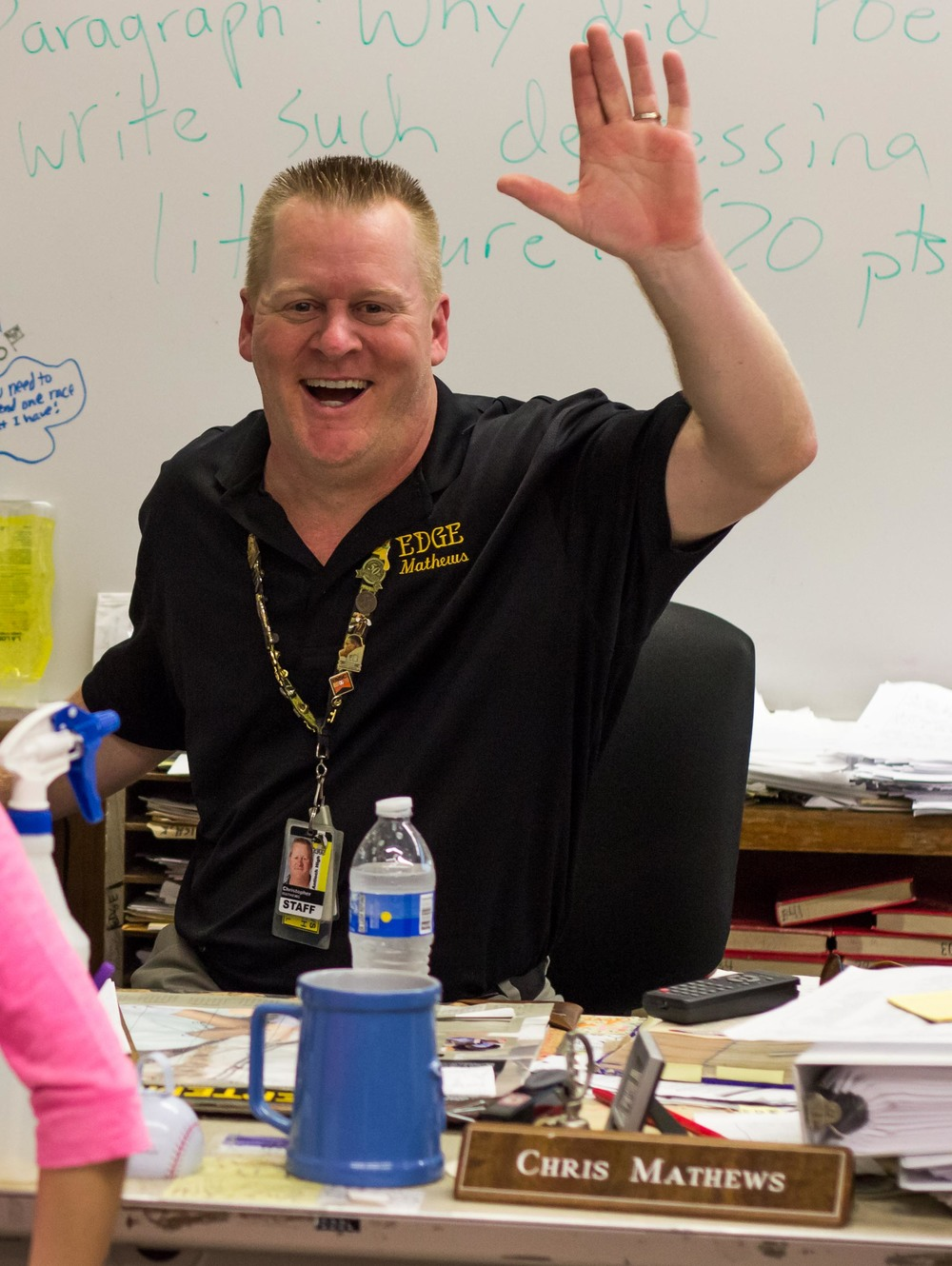 Mr. Mathews waves for the camera during Antioch High's 2014-2015 Back To School Night.