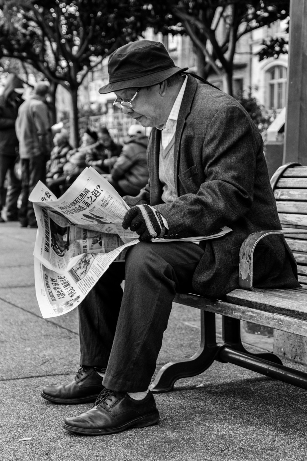 Here's a older gentleman reading his newspaper in Portsmouth Square.