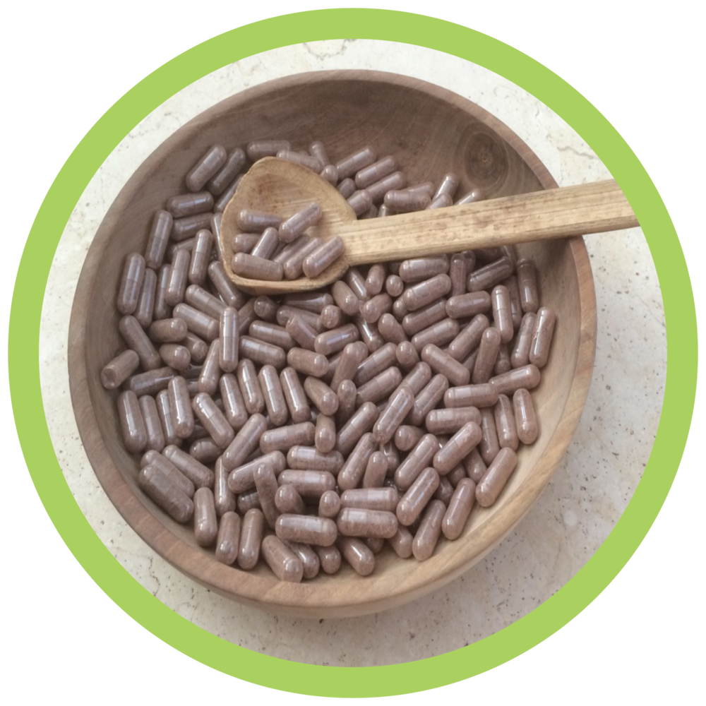 Wooden bowl of pills.png