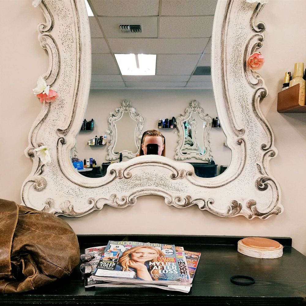 I love the mirrors at my hair salon, but I can hardly see myself over the frame!