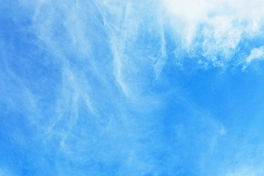 Wispy clouds and vibrant blue skies