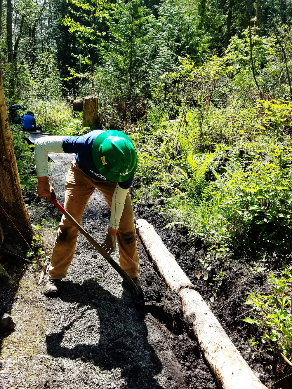 One of my new friends widening a trench to align one of three half-turnpikes to improve a particularly muddy stretch of trail