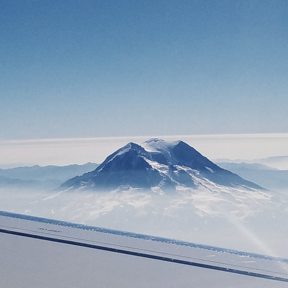 Looking down on smoke-shrouded Rainier from my flight south