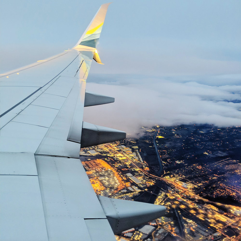 and the happy sight of low clouds over Seattle coming home