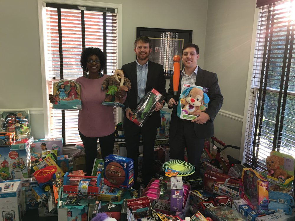 Last year's Baer Wealth Management Toy Drive to benefit Children's Restoration Network yielded a lot of toys and a lot of happy kids!  Kenny Baer, Sr. Wealth Manager and Managing Partner is flanked by Mark Beal, Personal Wealth Advisor and Sandra Clausen, Client Services Manager.   The 2017 Toy Drive is taking place now through Dec. 9, 2017.