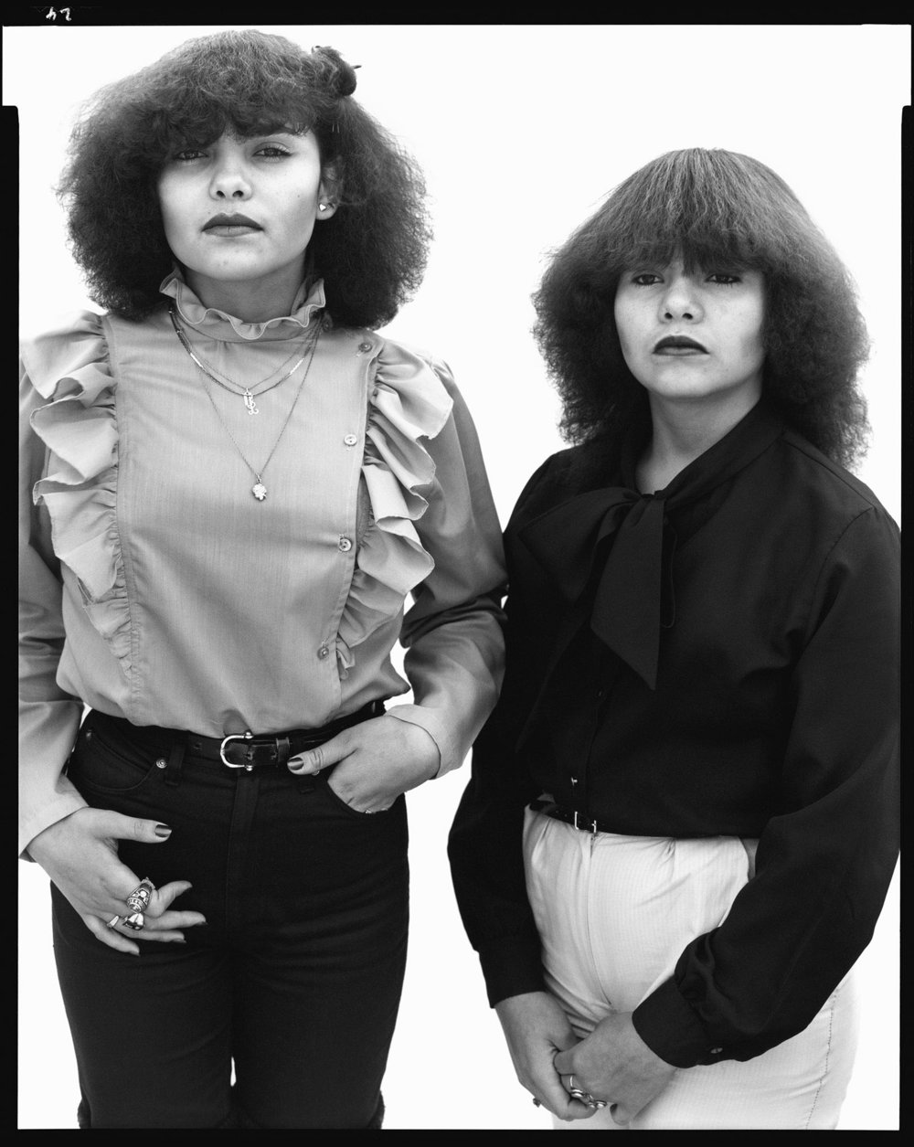 Myrna Sandoval, eighteen-year-old, and and her sister Claudia, fourteen-year-old, El Paso, Texas, April 20, 1982