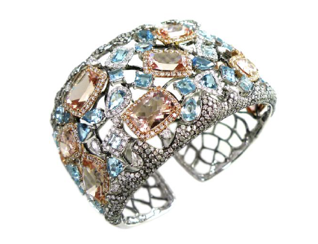 Diamond: 969 pieces.  Stone: 45 pieces.  Gold: 18k, 57.550 gms.  Width 40mm, 1 side open hinge.