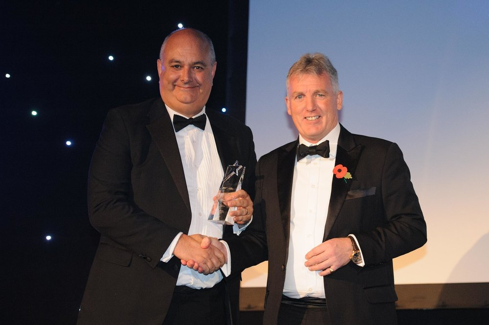 Ian Pollitt (left) receiving his award.