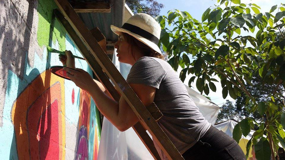 volunteer nurse and painter, michelle adyniec. the force behind the project.