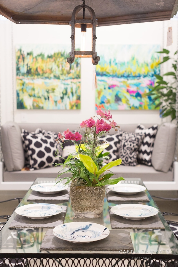 an orchid tablescape pairing perfectly with christopher spitzmiller plates in prussian blue.