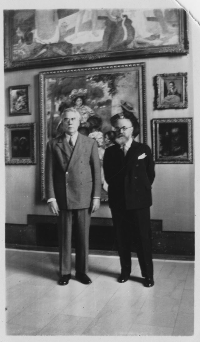 Photo of Dr. Barnes with Matisse  circa 1930 in front of a Renoir.