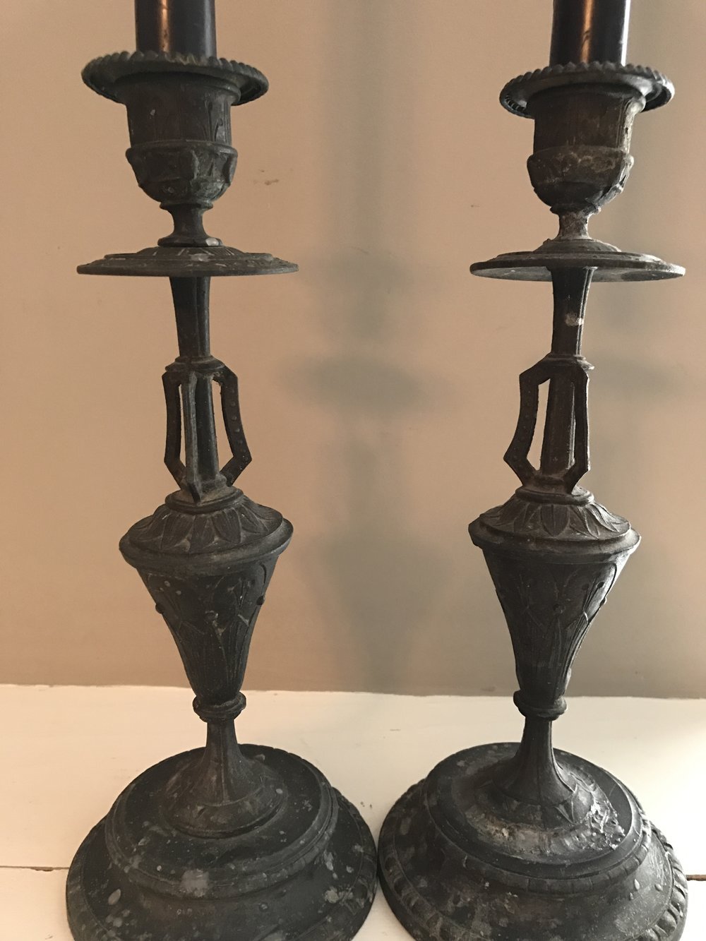A SET OF CANDLESTICKS PURCHASED IN A PARIS FLEA MARKET DURING ONE OF PAT'S FIRST EUROPEAN LAYOVERS.