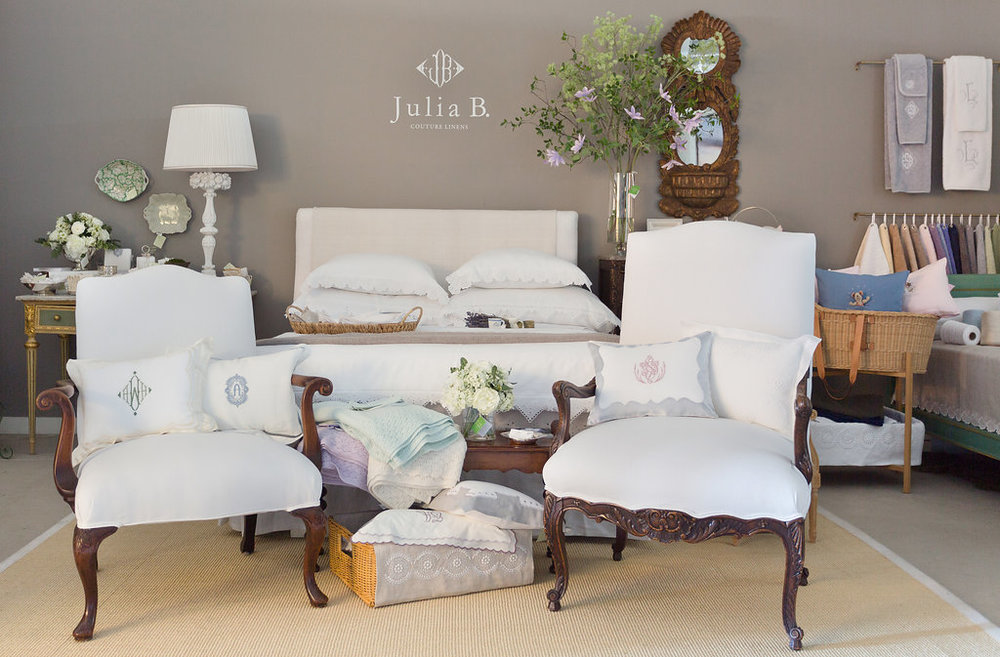Julia B's gorgeous Atelier featuring her custom embroidered bed and table linens as well as china, silver and gifts.