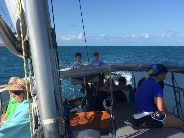 Boys sailing the boat home.