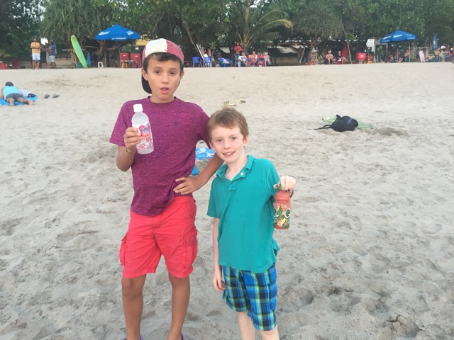 Both boys proud of their separate bartering success on the beach.