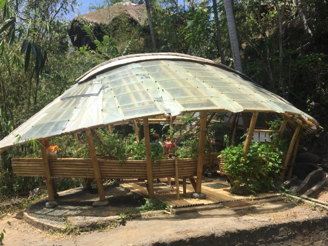the greenhouse.  made of reused car windshields
