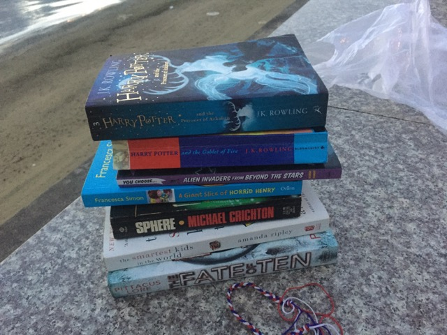 They were squirreling all these books into their luggage.