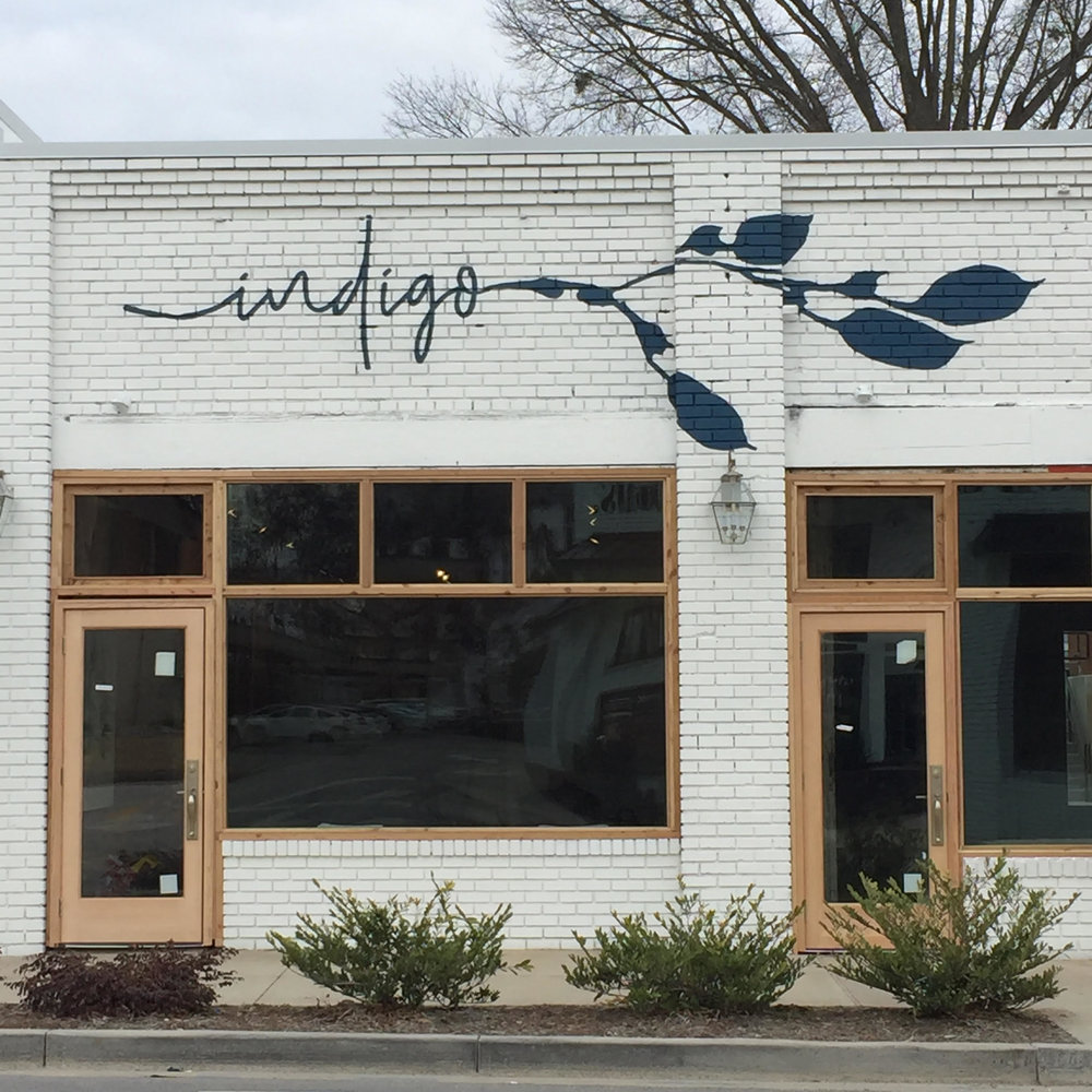Hand painted logo for Indigo Flow & Art, 1270 Pendleton St, Greenville, SC. Logo design by Rooted Brands. COmpleted in January, 2018.