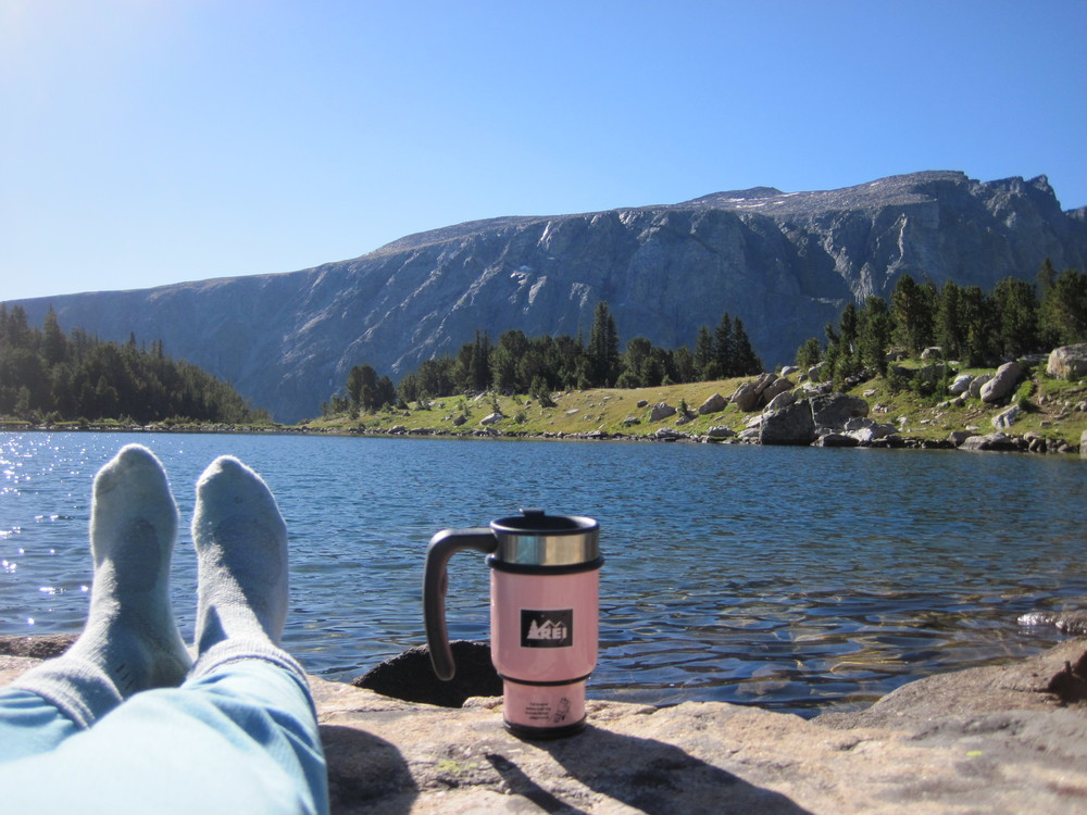 Adaptively managing my coffee consumption by an alpine lake in the Beartooth mountains in Montana. Photo credit Gretchen Hansen.