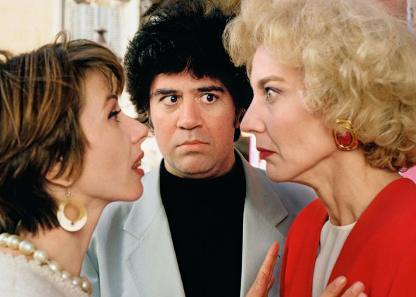 Almodóvar on set directing co-stars Victoria Abril and Marisa Paredes in High Heels.