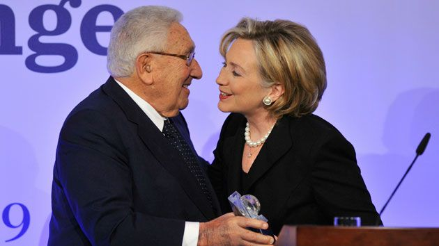 "Hillary and Bill Clinton regularly vacation with the Kissingers, and she has awarded ""herself the Kissinger seal of approval"" as Secretary of State ""to bolster her standing as a competent diplomat and government official."" (photo by Gero Breloer/AP in Mother Jones)"