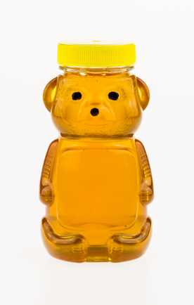 Honey in a plastic container shaped like a bear.